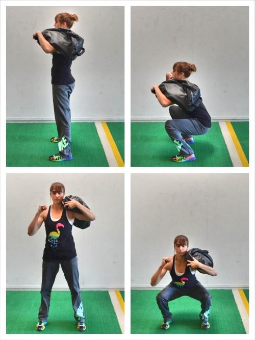 shouldered sandbag squat